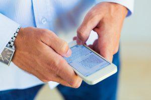 Man using smart phone, Texting