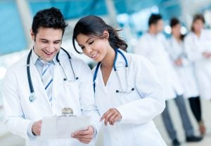 Doctors working at the hospital; navigating hipaa compliance