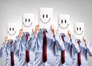 Business people with happy face posters